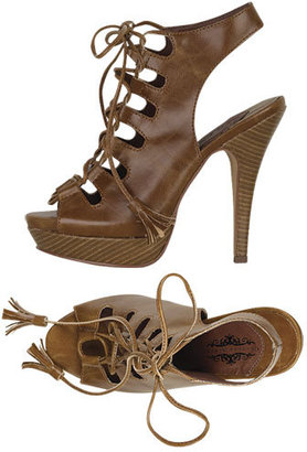 2e5d2fbeb18cd The Look for Less: Christian Louboutin Miss Fortune Lace-up Sandals ...